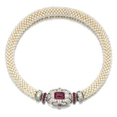 Seed pearl, ruby and diamond necklace, Mauboussin, 1930s.