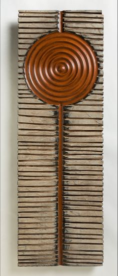 Sacral by Kipley Meyer. This carved poplar wall piece is painted using milk paint and finished with a wax treatment. Limited edition of 5.