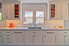 How do you add color *and* keep a kitchen timeless? Try painting the cabinet interiors a bold accent color, like pumpkin spice. (http://photos.hgtv.com/photo/timeless-white-family-kitchen-with-pop-of-orange?soc=Pinterest)