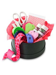 Christmas Gift Idea for a Hostess ~ Give a hostess gift that keeps on giving: a package of present-wrapping fixings to ensure that the holidays will be a little less hectic. It's as easy as finding a decorative box and filling it with a variety of ribbons, cards and tags, glitter, scissors, and snazzy wrapping gadgets like a ribbon curler and a pop-up tape dispenser