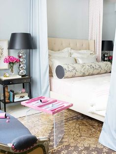 Elizabeth Bailey - Blue walls paint color, Turkish Oushak Rug, gray silk bed drapery lined with Rubie Green East Village Pink Fabric, vintage chrome ball lamps with black shades, Cisco Brothers Francesca Bed and glossy black table nightstand.