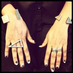 @Erin B B B B B Butler des Quatres's jewelry complements her geometric nails perfectly. That triangle ring is sick.