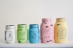 tutorial for distressed mason jars with spray paint - spray paint inside darker color & outside with darker color, then use sandpaper to distress