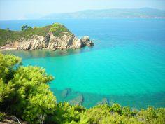 Transparent ocean in Mandraki bay on Skiathos