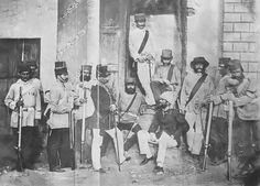 EIC 1st European Bengal Fusiliers taken following the capture of Lucknow ...wearing fighting smocks.c1857.