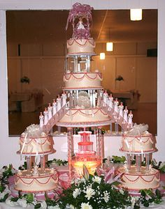 Traditional Quinceanera Cake... With the water foundation at the bottom, damas on the stairs and the quinceanera on top