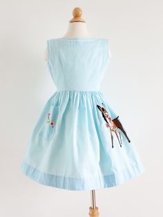 """1960s girls sundress from #MontegoBayJamaica. Sky blue cotton with 3D floral embroidery and that #donkeyapplique- swipe left! 🐴 B28"""" w24"""" L23-26"""". From an estate sale in Eau Claire, WI.  The affluent family traveled all over the world during the mid century.  Their home proudly displayed all their treasures from their travels including a closetful of vintage children's clothes from Paris, England, Italy and Jamaica! 🌐✈️"""