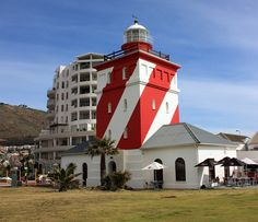 The Mouille Point Lighthouse is found safeguarding shipping off the sometimes trecherous Cape coastline. The structure is a heritage site (previously called National Monuments). Beacon Of Light, Dream City, Heritage Site, Windmill, Cape Town, Places To See, South Africa, Lighthouses, Cool Photos