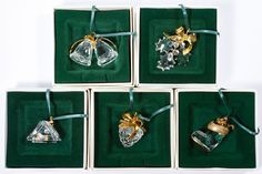 """Lot 356: Swarovski Crystal """"Memories"""" Ornament Assortment; Five ornaments including a house, boot, bells, pine cone and holly"""