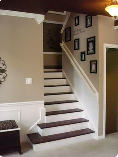 I would LOVE to rip out the carpeting on my stairs and do this DIY project....if only I were so brave! I just love everything about this stairway- paint colors, picture frames, etc!
