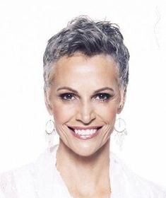 .. This is striking and I am especially fond of her salt and pepper hair... I'm in that category now, waiting for more silver strands!! Great cut!!