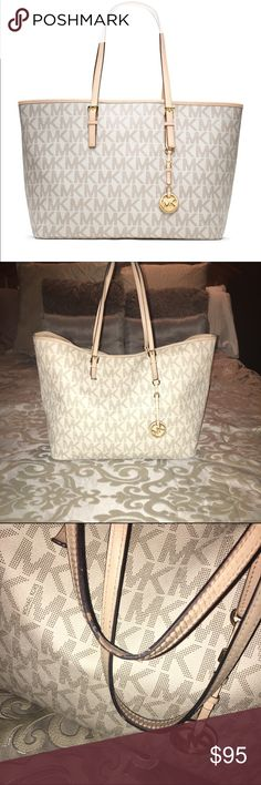 Michael Kors Jet Set Travel Tote Michael Kors Vanilla Logo Tote Used. Handles are a bit worn and there is a reddish lip stick stain inside at the bottom (may be removable) Aside this bag is super spacious and beautiful ❤️ Michael Kors Bags
