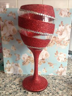 Red glitter wine glass with crystal rhinestones.