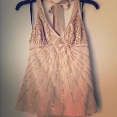 Bebe sequin halter top ( almost a tan peach color) Silky, sexy sequined halter top. Super comfortable with flattering lines.  In excellent condition.                                                          92% silk.                                                                   Dry clean only bebe Tops Tank Tops