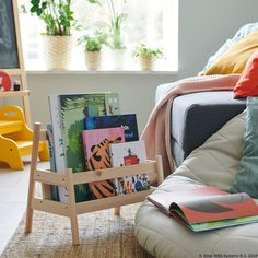 This low book display allows your child to reach their books. If the choice is still too hard, you can take it with you to the reading corner. Childrens Storage Boxes, Childrens Storage Furniture, Kids Toy Boxes, Nursery Furniture Sets, Storage For Books, Cube Storage, Wall Storage, Storage Baskets, Cosy Reading Corner
