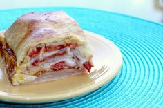 "Kentucky Hot Brown Bake  Kentucky Hot Brown Bake Yields: 9 servings  Ingredients  8 oz package refrigerated crescent rolls 1 lb. package smoked turkey lunch meat 8 slices cooked bacon 8 slices Swiss cheese 3 Roma tomatoes, sliced thin 4 eggs, beaten (I recommend only 3 since 4 was a little much) Directions  Preheat oven to 350 degrees F. Unroll the crescent dough and separate into 2 squares. Set one square aside, and place the other square in the bottom of 8"" pan that is greased or lined with pa"