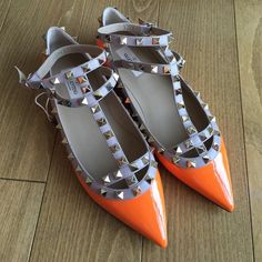 BNIB Valentino rockstuds caged flats fluo Orange NO TRADES Brand new in box, never worn. Authentic neon orange valentino rockstud caged flats. Beautiful, statement shoes! Dress the up and down. A true staple in the fashion crowd. Size 38.5 patent leather they come with box and dust bag. Valentino Shoes Flats & Loafers
