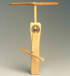 Wooden flying toy... well... maybe my husband will make this in his wood shop. ;)