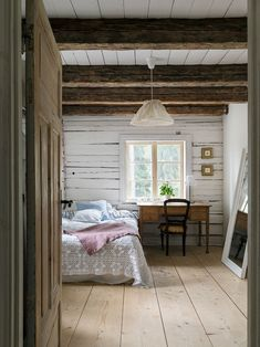 Beautiful natural bedroom in wooden cabin.