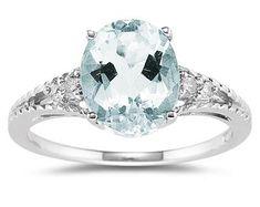 ApplesofGold.com - 1.75 Carat Oval Cut Aquamarine & Diamond Ring in 14K White Gold