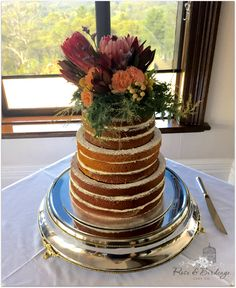 Naked caramel mud cake with vanilla bean buttercream, finished with an amazing flower arrangement hand made by the gorgeous bride. www.roseandbirdcage.com