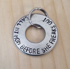Stainless steel washer dog identification tag with name and phone number. Sized for Medium & Large dogs