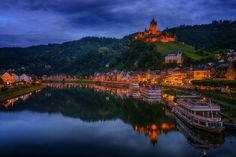 Romantic Cochem And Imperial Castle ... - Small Series: Castles in Germany, South West ( 6 of 8 )  Cochem Castle on the Mosel River was mentioned in 1130 for the first time. 1151 sent by King Conrad III. occupied and declared the imperial castle. The town of Cochem is dominated by tourism. Focus here is Cochem Castle, The importance of wine growing declined sharply in recent decades. While many slopes were planted in the urban area until the 1970s and 1980s with vines, most of the former…