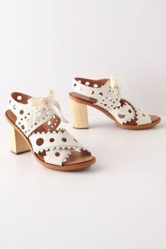 I love the whimsical cutout detailing on these chunky soled sandals.