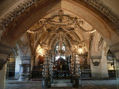 """Kutna Hora, Czech Republic The """"bone church"""" south of Prague - decorated with the bones of 1000's of plague victims. Fascinating and macabre!"""