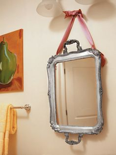 Saw lots of these at the antique mall---silver trays hung with ribbon as wall decorations.