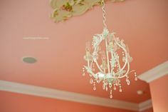 A soft accent coral wall in 'Coral Reef' by Benjamin Moore or Behr 'Coral Bells'