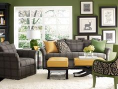 not loving the couch or chair (grey ones)...but the wall color with your framed photos??