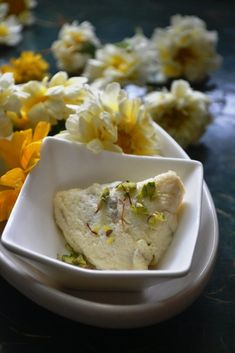 Malai Paan or Balai ki Gilouri is a delicate sweet made with paper thin malai filled with mishri and dry fruits. Nowadays mawa is also used in filling an… Indian Dessert Recipes, Indian Sweets, Sweets Recipes, Diwali Recipes, Indian Snacks, Indian Recipes, Desert Recipes, Burfi Recipe, Chaat Recipe