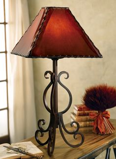 Table dining table rod iron rustic kitchen pinterest iron old west iron lamp w rawhide shade aloadofball Image collections