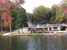 Lakeside view of the front of the house, covered patio, open patio and swim area