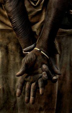 WEATHERED HANDS: Kara woman, Omo River Valley, Ethiopia. (Photo by Nicholas Wiesnet)