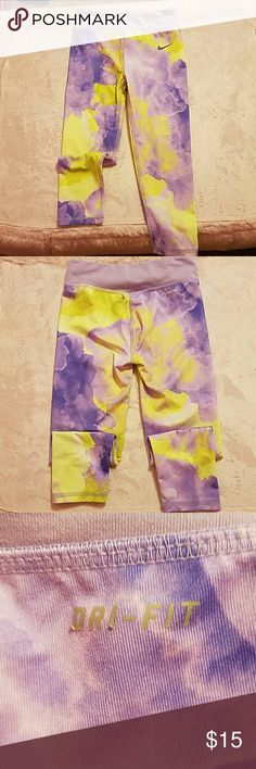 """Nike DRI-FIT Girls Leggings Pale purple & yellow. Sooooo very cute on!! Perfect condition, only wore a couple times. Only thing not """"perfect"""" is that the """"DRI-FIT"""" on the back is beginning to peel. These have been hung to dry, I don't dry any of my daughters clothes in the dryer. Smoke & pet free home. Offers always welcome!!!  ?? Nike Bottoms Leggings"""