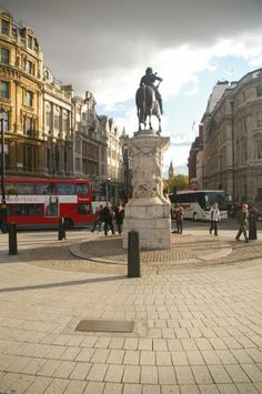 """Charing Cross is officially recognized as the centre of London. A plaque marks the spot at the top of Whitehall, at the south of Trafalgar Square. The plaque reads: """"On the site now occupied by the statue of King Charles I was erected the original Queen Eleanor's cross, a replica of which stands in front of Charing Cross station. Mileages from London are measured from the site of the original cross."""" L. Hickey"""