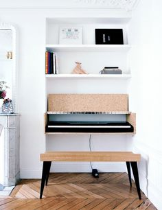 How to Display Musical Instruments as Décor | DomaineHome.com // Keyboard in simple custom built case.