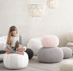 Knit Cotton Pouf. knit cotton pouf $99 - $169 Casual, soft-sided seating like our pouf is ideal in a child 's room – the small scale fits little arms and legs beautifully and youngsters can move it all by themselves. The round shape and soft, nubby texture add a pop of personality too. Crafted with a knitted cotton cover and dense polystyrene bead fill. Available in small or large. Due to handmade construction, poufs may be stiff upon arrival, but will soften over time with use. RH baby…