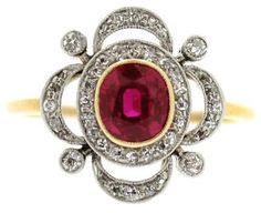 This antique ruby and diamond cluster ring was made in 1905. The ring is yellow gold with platinum, the central ruby is 1 carat, surrounded by 0.44 carats of diamonds.  Via Diamonds in the Library.