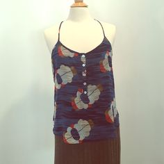 Cute Quicksilver racerback Tank top Easy breezy too to throw on with jeans, shorts, maxi skirt- you get the gist! Top is lined in navy and straps are adjustable. Quiksilver Tops Tank Tops