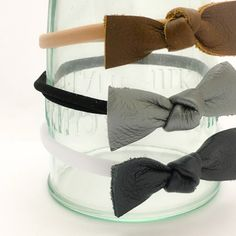 Hand cut and tied real leather knot bow. Bows measure 2. You can have the bow attached to a clip or one size fits all soft nylon elastic. **This