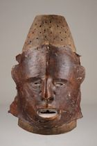"""Janiform dance crest - The Akparabong are an Ejagham clan living along the Aweyong, an upper Cross River tributary. They produce for their """"ekpe"""" society refined skin-covered dance crests and helmet masks of a distinctive style often incorrectly thought of as classic Ekoi.  H: 46 cm"""