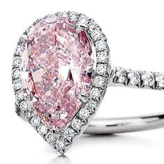 Think out the traditional clear diamond.The classic pear shape goes ultra-romantic in a pink diamond ring. Pink Diamond Engagement Ring, Colored Engagement Rings, Pink Diamond Ring, Diamond Wedding Rings, Diamond Jewelry, Leo Diamond, Pink Sapphire, Bling Bling, Tiffany And Co