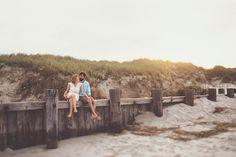 Folly Beach lifestyle engagement portraits | Engaged couple together on the beach | Charleston Engagement Photographers @billiejojeremy  #charlestonengagment #follybeach #charlestonphotographers #husbandandwifephotographers #engaged #engagement #lifestylephotography #beach #lifestyleengagement #portraits  #getoutside #outdoors #active #liveauthentic