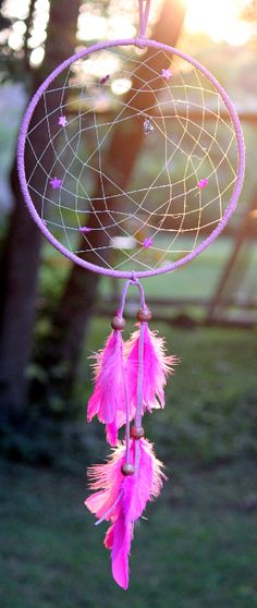 Lucky Star Dream Catcher - This dream catcher is 10 inches - wrapped in pink leather ... decorated with pink glass star beads and a silver heart pendant that hangs in the center - and lets not forget the bright pink feathers flowing from the bottom.