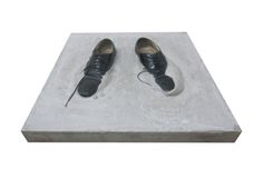 "Michael Linares, Untitled (inertia),2012.  Concrete and shoes, 24 x 24 x 6"". Image courtesy the artist."