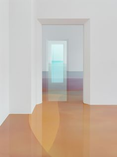 """Painter Peter Zimmermann has moved his colorful hues from canvas to floor in his latest exhibition """"Freiburg School,"""" at the Museum für Neue Kunst in Freiburg, Germany. The installation is composed of bright blue, pink, and peach resin that appears like a candy-colored lagoon beneath t"""