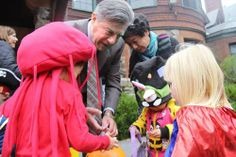 Interim President Joe Lee hands out Halloween candy to kids on campus